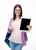 Woman showing tablet computer screen and thumb up Royalty Free Stock Image