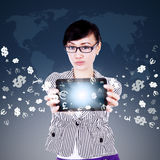 Woman showing tablet with currency symbols. Image of young asian woman showing digital tablet screen with currency symbols flying away. Making money online Stock Photography