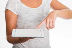 Woman showing tablet in her hands Royalty Free Stock Image