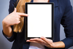 Woman showing a tablet PC. Stock Photos