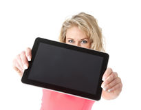 Woman showing tablet pc Stock Images