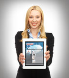 Woman showing tablet pc with news Royalty Free Stock Images