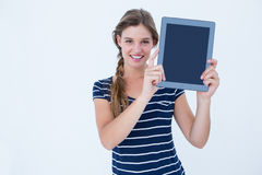 Woman showing tablet pc Stock Image