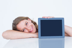 Woman showing tablet pc Royalty Free Stock Photo