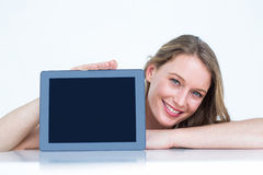 Woman showing tablet pc Royalty Free Stock Images