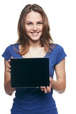 Woman showing tablet screen smiling Stock Photo