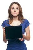 Woman showing tablet screen smiling Royalty Free Stock Image