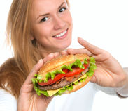 Woman showing tasty unhealthy burger sandwich Royalty Free Stock Images