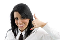 Woman showing telephonic hand gesture Stock Photo