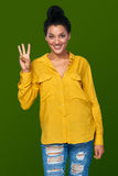 Woman showing three fingers Stock Images