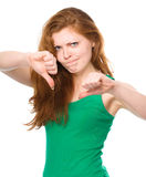 Woman is showing thumb down gesture Royalty Free Stock Photo