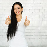 Woman showing thumb up Stock Photo
