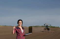 Woman showing thumb up in field Royalty Free Stock Images