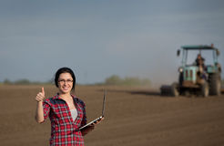 Woman showing thumb up in field Royalty Free Stock Photo