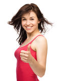 Woman is showing thumb up gesture Royalty Free Stock Photo