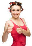 Woman is showing thumb up gesture Stock Photos
