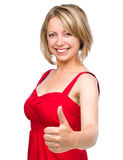 Woman is showing thumb up gesture Royalty Free Stock Photography