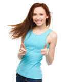 Woman is showing thumb up gesture Royalty Free Stock Photos