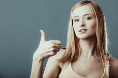 Woman showing thumb up hand sign gesture Stock Image