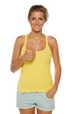 Woman showing thumb up sign Stock Image