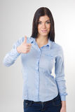 Woman showing thumb up sign Stock Photography