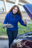 Woman showing thumb up standing in front of car Royalty Free Stock Photos