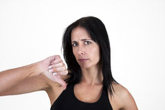 Woman showing thumbs down. Negative stock images