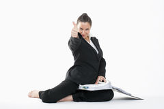 Woman showing thumbs up Stock Images