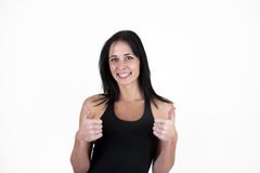Woman showing thumbs up. Positive Stock Images