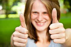 Woman showing thumbs up Stock Photography