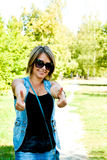 Woman showing thumbs up Royalty Free Stock Images