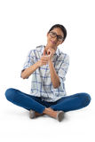 Woman showing thumbs up against white background Royalty Free Stock Images