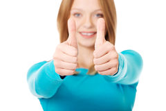 Woman showing thumbs up with both hands Royalty Free Stock Photos