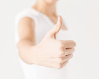Woman showing thumbs up Stock Photos