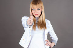 Woman showing thumbs up gesture Stock Photography