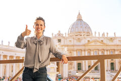 Woman showing thumbs up on piazza san pietro Stock Photos