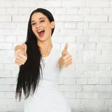 Woman showing thumbs up sign Royalty Free Stock Images
