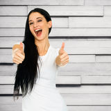 Woman showing thumbs up sign Royalty Free Stock Image