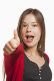 Woman showing thumbs up sign Royalty Free Stock Photography