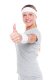 Woman showing thumbs up and smiling Royalty Free Stock Photos