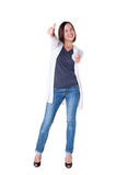 Woman showing thumbs up and smiling Royalty Free Stock Images