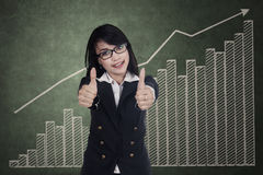 Woman showing thumbs up Stock Image