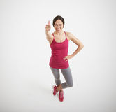 Woman showing thumbs up and smiling Royalty Free Stock Photography