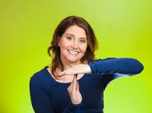 Woman showing time out gesture with hands Stock Photo