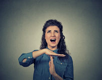 Woman showing time out hand gesture, frustrated screaming to stop Stock Image