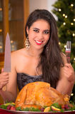 Woman showing to the camera Christmas turkey for Royalty Free Stock Photography