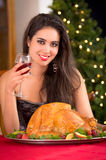 Woman showing to the camera Christmas turkey for Royalty Free Stock Photos
