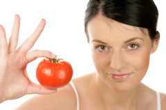 Woman showing tomato Royalty Free Stock Photos