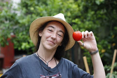 Woman showing a tomato Royalty Free Stock Photography
