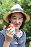 Woman showing a tomato Royalty Free Stock Photo